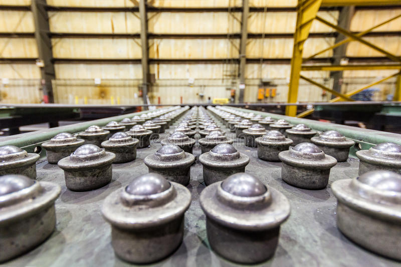 Roller ball bearing table with old bearings in warehouse. Roller ball bearing table with old bearings in old housings in warehouse with metal girders stock photography