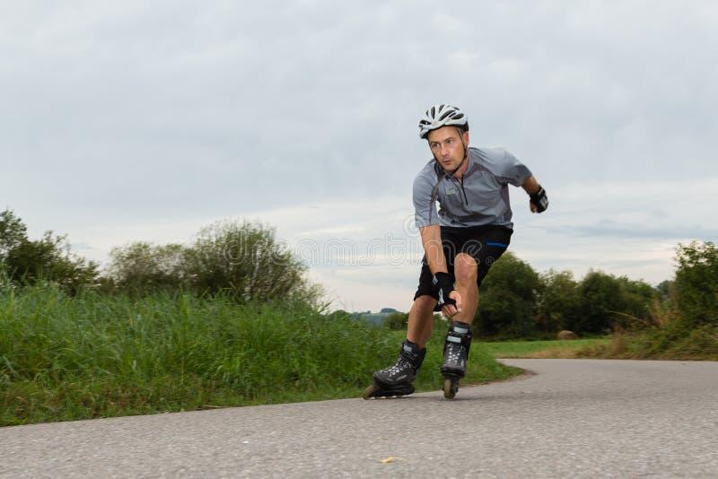Roller blading. Athlete is blading on skates royalty free stock image