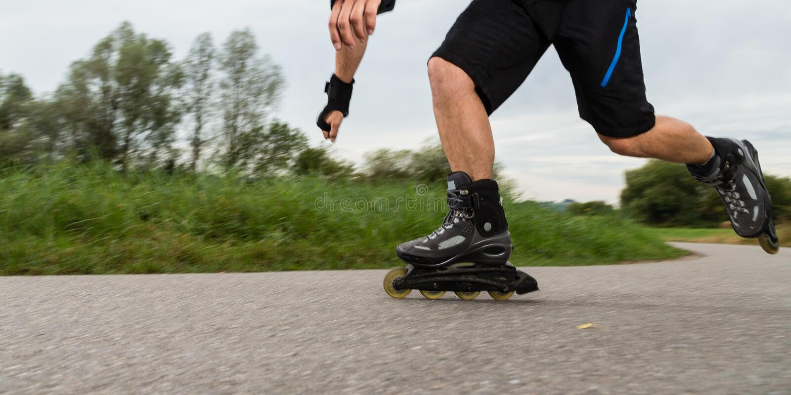 Roller blading. Athlete is blading on skates royalty free stock photography