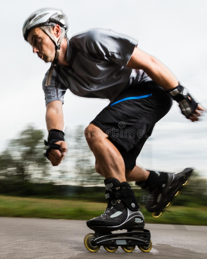 Roller blading. Athlete is blading on skates in blurred motion royalty free stock photos