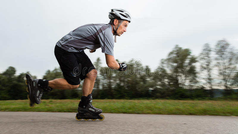 Roller blading. Athlete is blading on skates in blurred motion stock photos