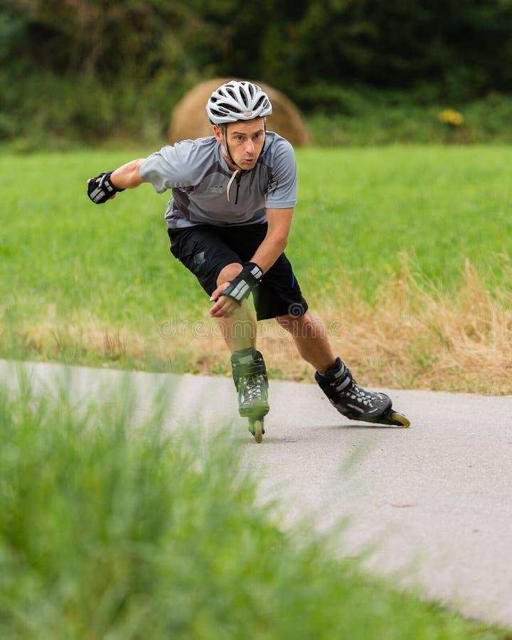 Roller blading. Athlete is blading on skates stock photography