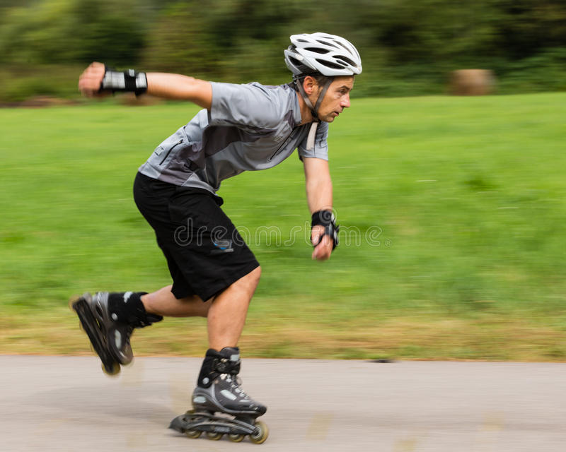 Roller blading. Athlete is blading on skates in blurred motion royalty free stock photo