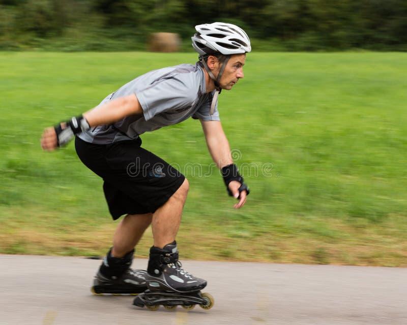 Roller blading. Athlete is blading on skates royalty free stock images