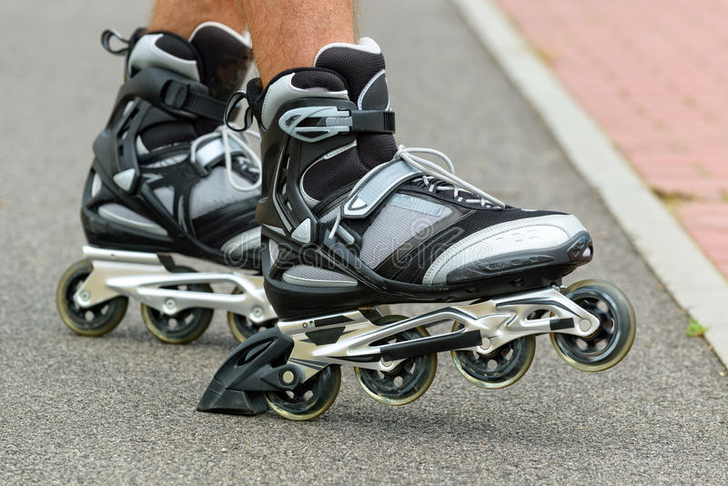 Roller blading legs. Roller blading outdoors, male legs royalty free stock images