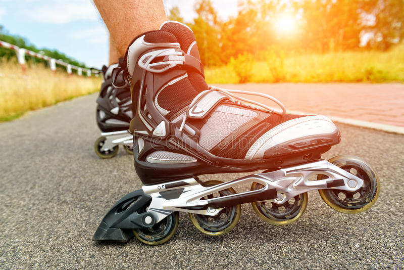 Roller blading legs. Roller blading outdoors, male legs royalty free stock photography