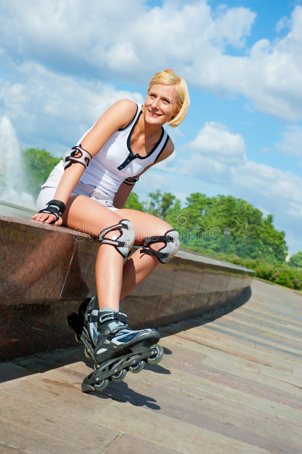 Roller blonde girl resting royalty free stock images