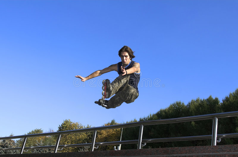 Download Roller Boy Jumping From Parapet Stock Image - Image: 3653629