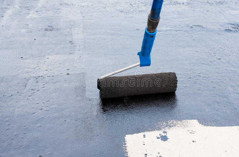 Roller brush waterproofing royalty free stock photography
