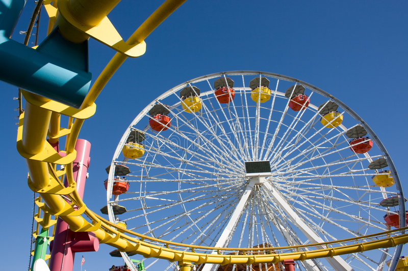 Roller coaster and big wheel royalty free stock images
