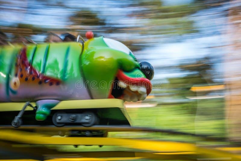 Roller coaster de Caterpillar no funpark imagem de stock royalty free