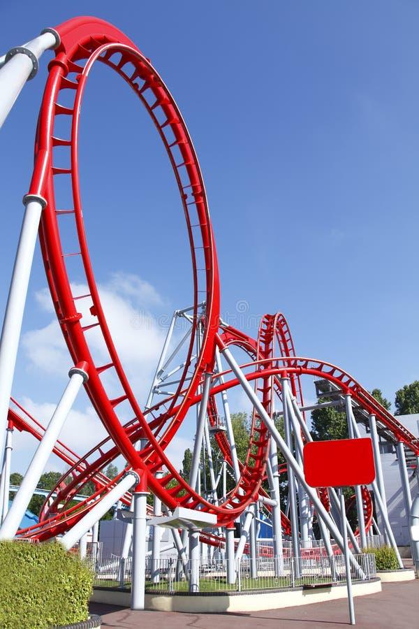 Roller coaster loop. Red roller coaster loop ride at funfair theme park stock photos
