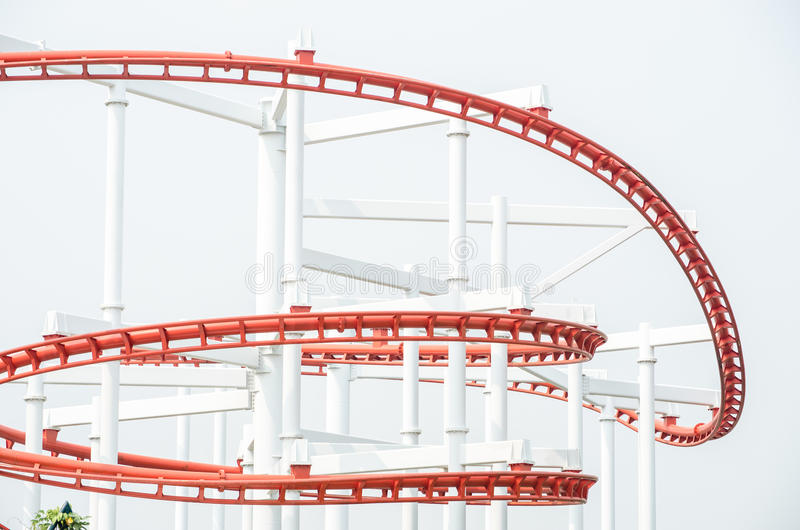 Roller coaster. Red roller coaster loop ride at funfair theme park royalty free stock photography