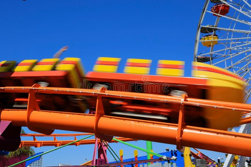 Roller coaster Santa Monica Pier. Action shot of Santa Monica Pier roller coaster royalty free stock image