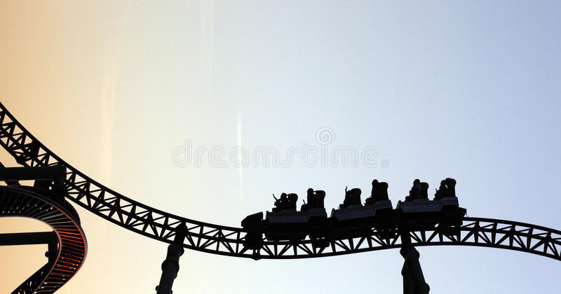 Roller coaster silhouette. At sunset