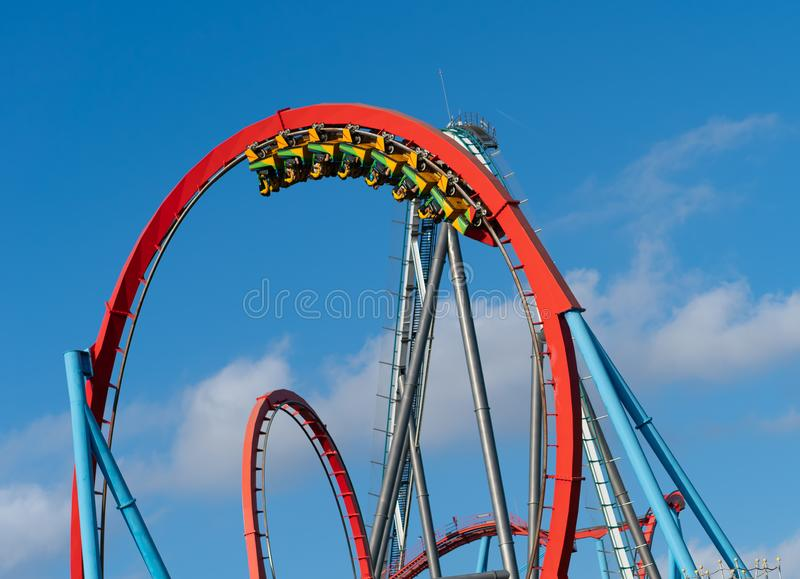 Roller coaster in theme park. Roller coaster with train full of people in theme park stock image