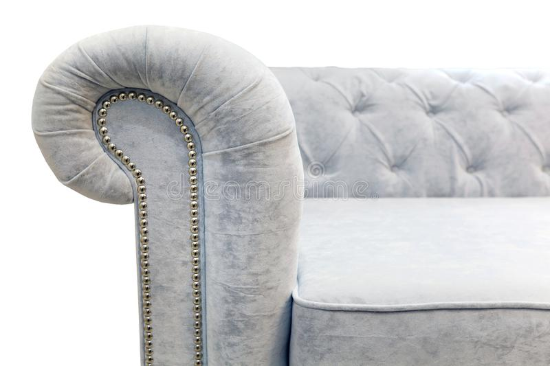 A roller, a handrail of a light sofa with rivets on a white background stock photography