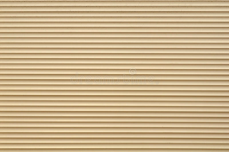 Roller Shutter Background. A beige roller shutter door as a background royalty free stock photography