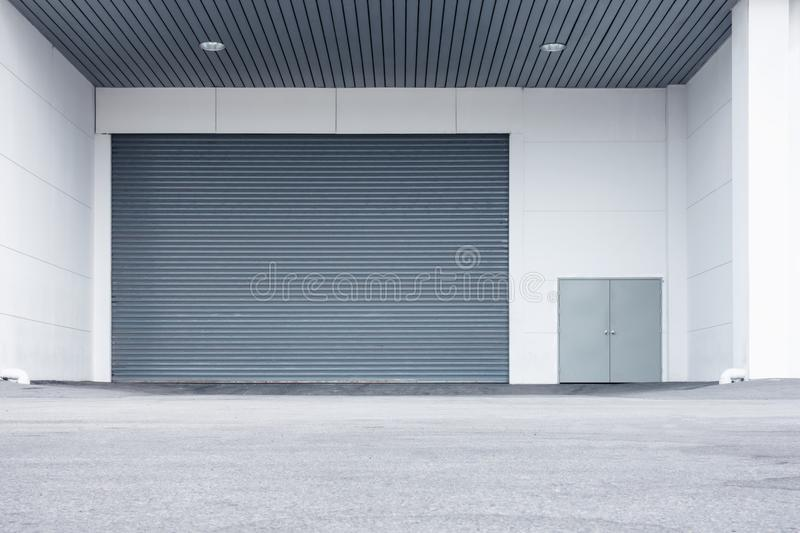 Roller shutter door and gate of warehouse materials storage royalty free stock photo