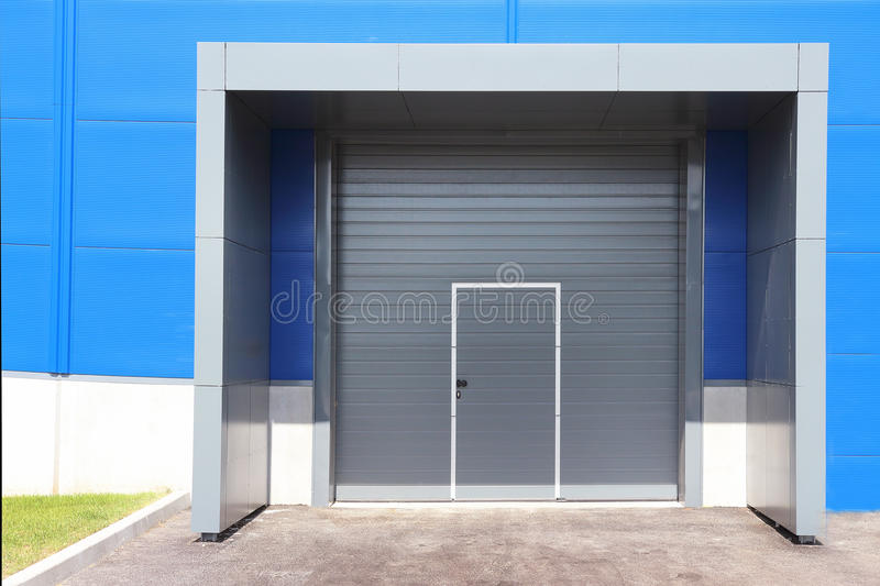 Roller shutter door of logistic center for industrial background. Transport company stock photo