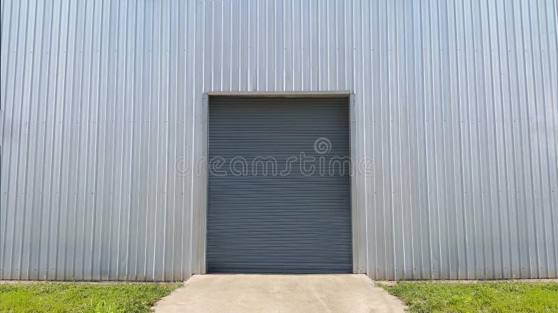 Roller shutter door metallic industrial frame.  on white metal sheet background royalty free stock photos