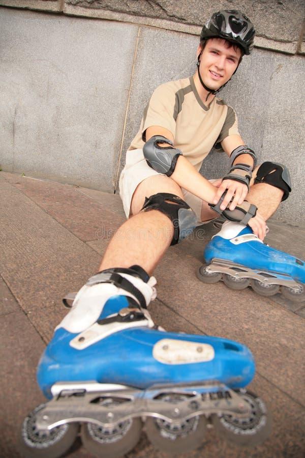 Download Roller sits under  wall stock image. Image of helmet, knee - 6580357