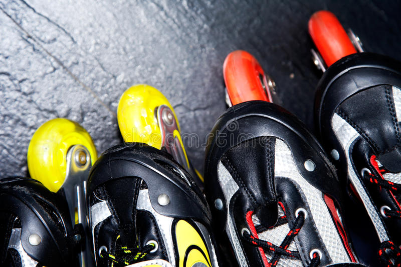 Roller skates. Two pairs of roller skates on the floor stock photography