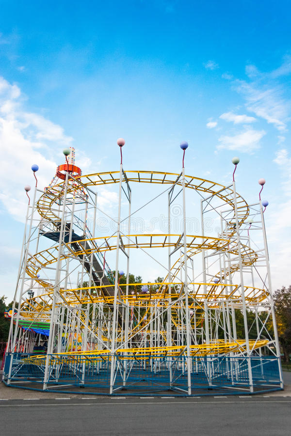 Download Rollercoaster In The Evening Against Blue Sky. Stock Image - Image: 47595689