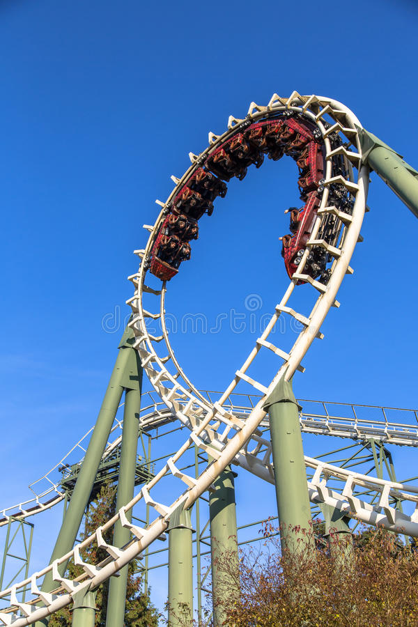 Rollercoaster ride at a theme park. People enjoying an exhilerating rollercoaster ride at a theme park stock photos