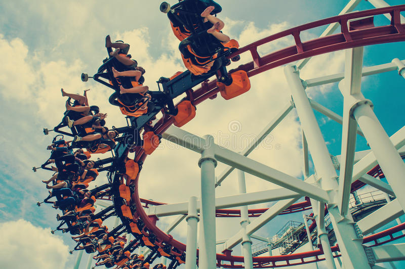 Rollercoaster ride at theme park. Vintage style stock photos