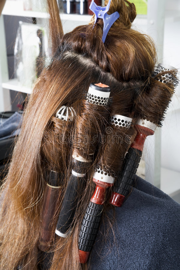 Rollers on long hair stock photography