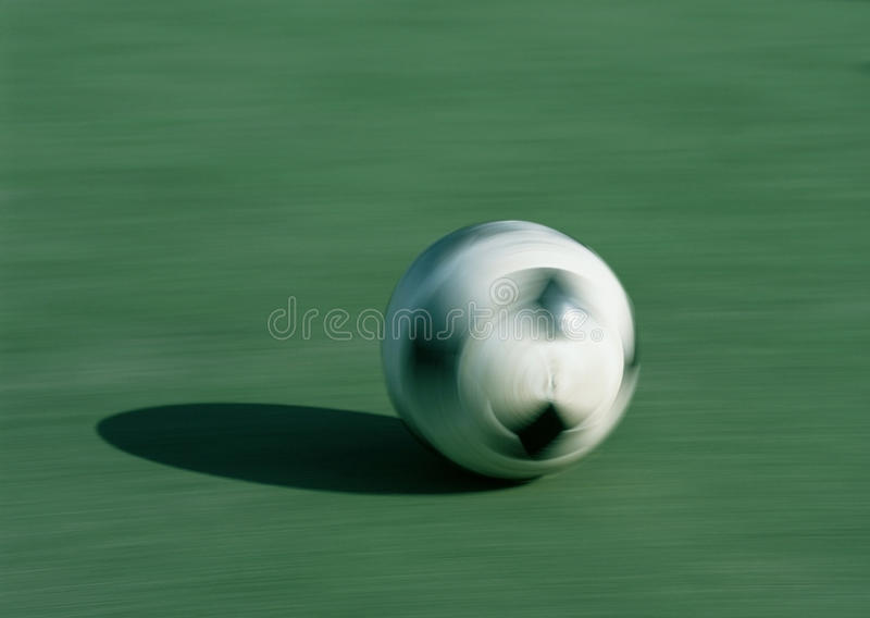 Rolling a ball on the green lawn royalty free stock image