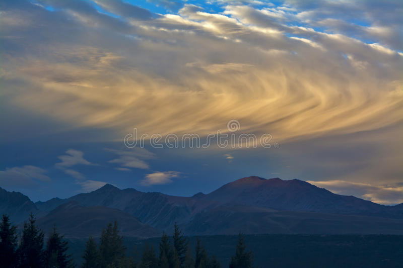 Rolling clouds above mountains before sunset, Aoraki Mount Cook National Park, New Zealand.  stock photos