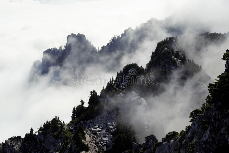 Rolling clouds in the Mountains. Amazing view of the clouds rolling through the mountains royalty free stock photo