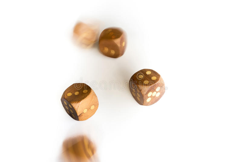 Rolling dice on white background royalty free stock photo