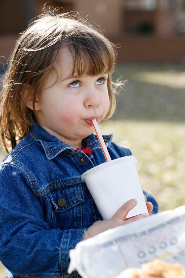Rolling Eyes Backwards While Drinking a Soda stock photography