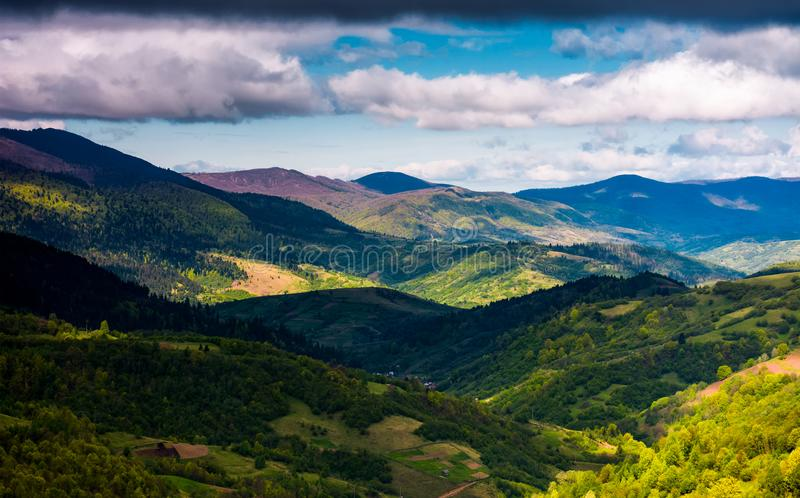 Rolling forested hills on a cloudy springtime day stock photos