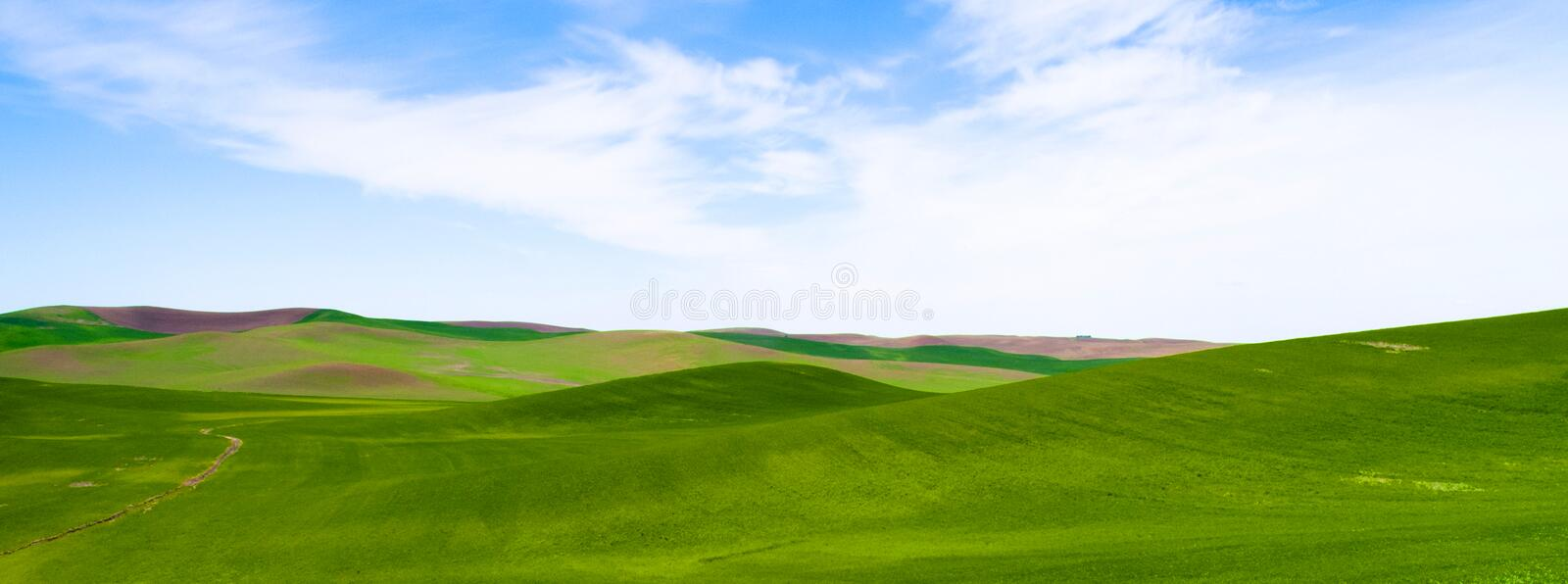 Rolling Green Hills Agricultural Land Partly Cloudy Blue Sky stock photos