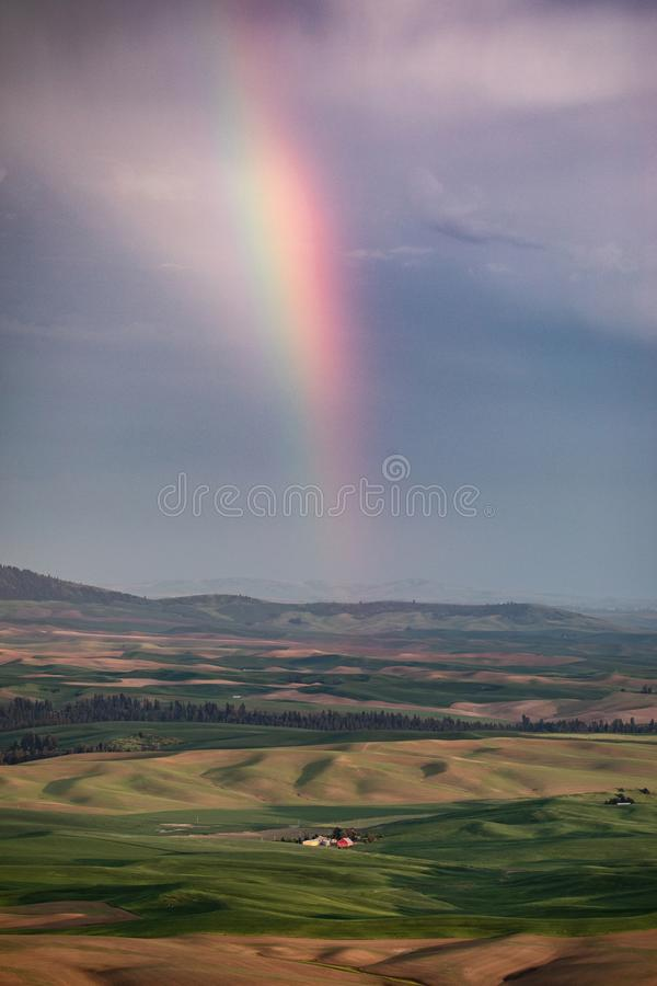 Rainbow over Rolling hills royalty free stock images