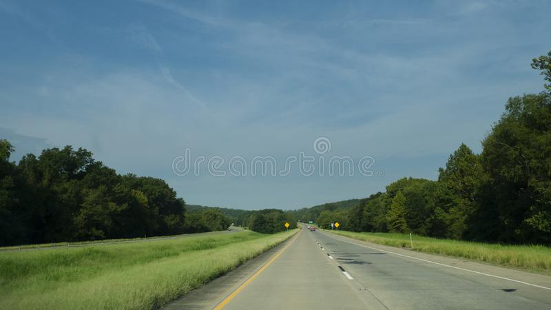 Rolling hills along I-40 in eastern Oklahoma. Rolling hills, small mountains and light traffic on the interstate in Eastern Oklahoma. September 10, 2019, the royalty free stock photos