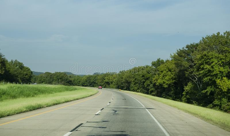 Rolling hills along I-40 in eastern Oklahoma. Rolling hills, small mountains and light traffic on the interstate in Eastern Oklahoma. September 10, 2019, the stock photos