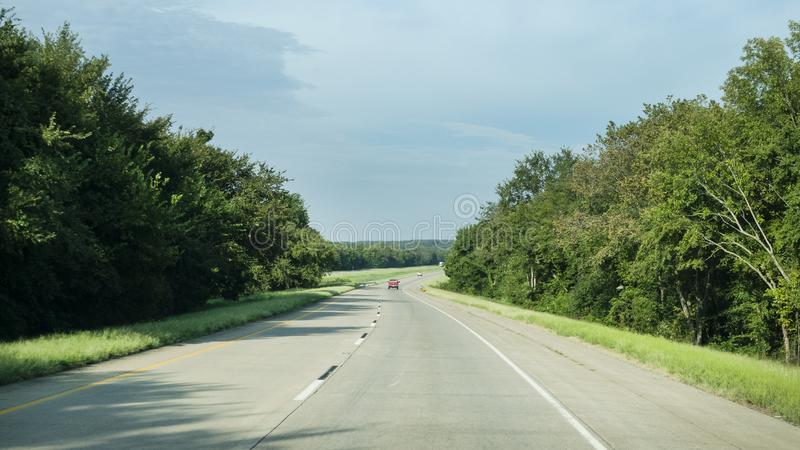 Rolling hills along I-40 in eastern Oklahoma. Rolling hills, small mountains and light traffic on the interstate in Eastern Oklahoma. September 10, 2019, the stock images