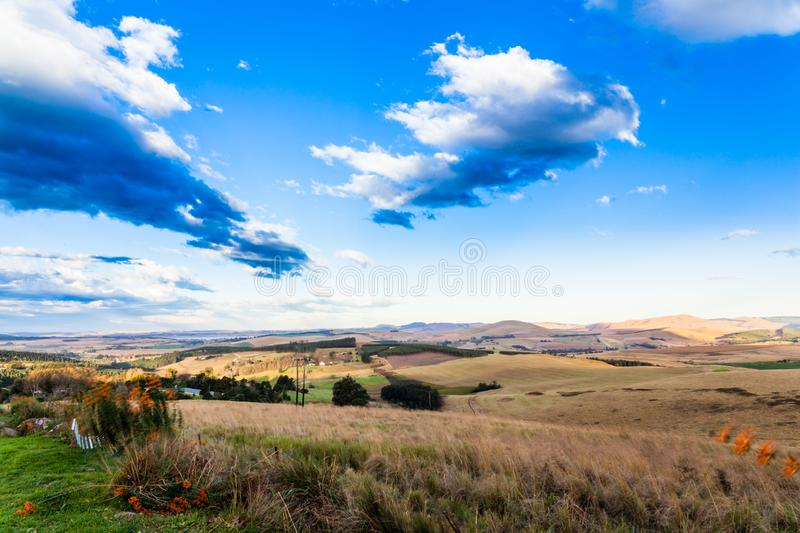 The rolling hills and fertile valleys of the Dargle, Kwazulu-natal, South Africa. The rolling hills and fertile valleys of the Dargle on a fresh winter morning royalty free stock image