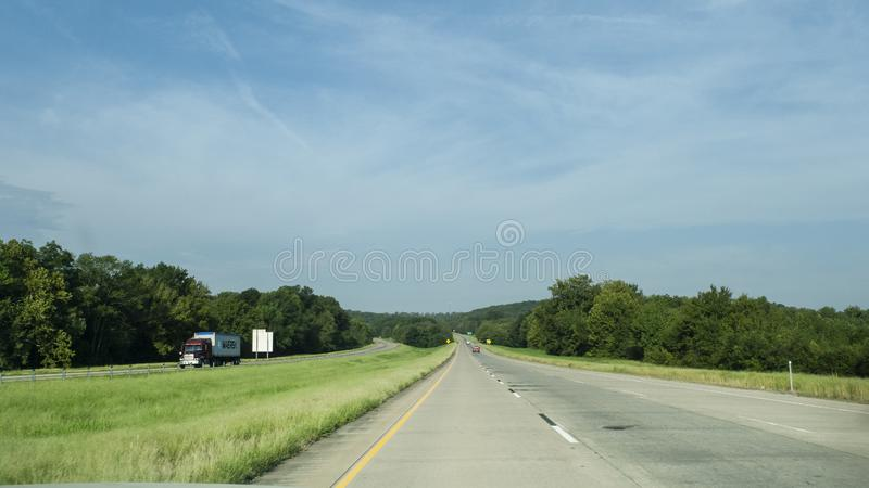 Rolling hills along I-40 in eastern Oklahoma with light traffic. Rolling hills, small mountains and light traffic on the interstate in Eastern Oklahoma stock photos