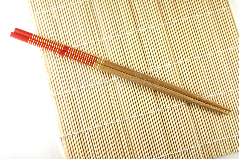 Rolling mat and chopsticks stock images