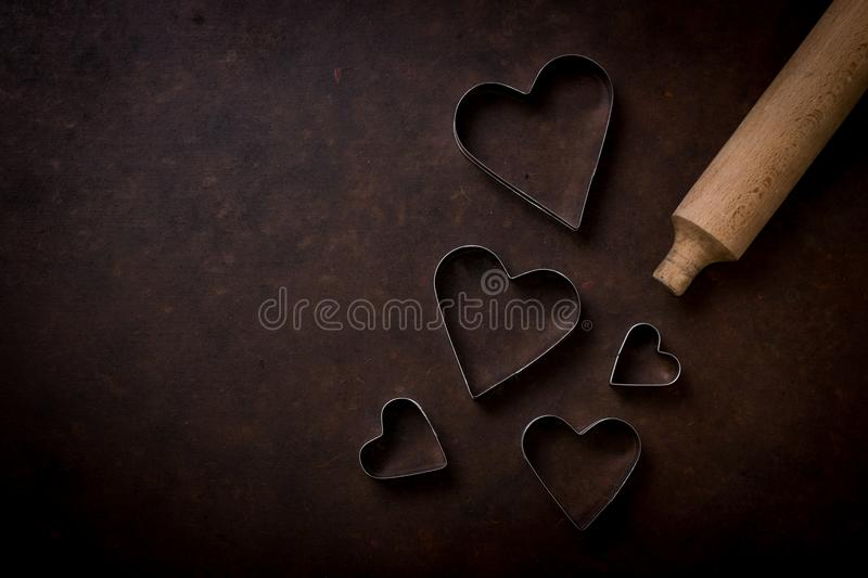 Rolling pin with cookie cutters in the shape of a heart stock photo