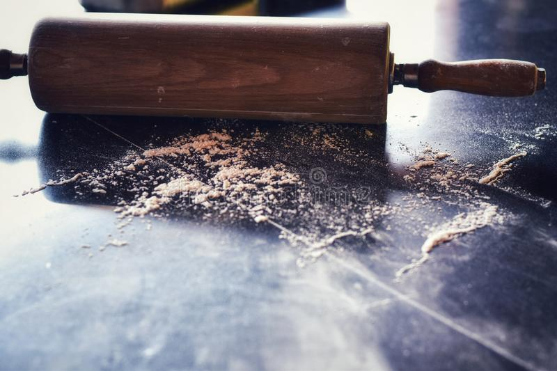 Rolling pin in the kitchen there is a cooking dough is elements stock photos