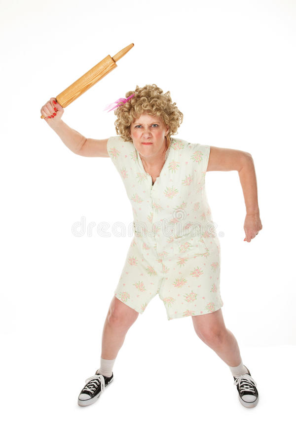 Rolling Pin Punishment. Angry housewife with rolling pin on white background royalty free stock photos