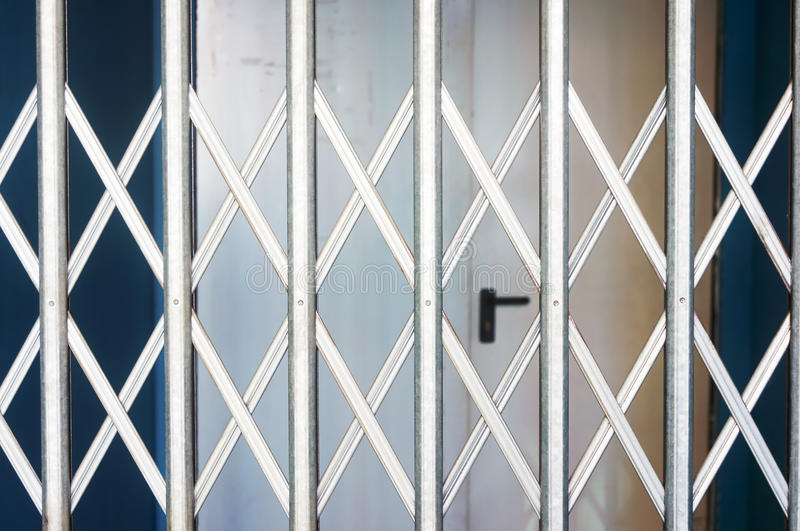 Rolling shutters closed in shop. Rolling shutters closed for shop protection stock photo