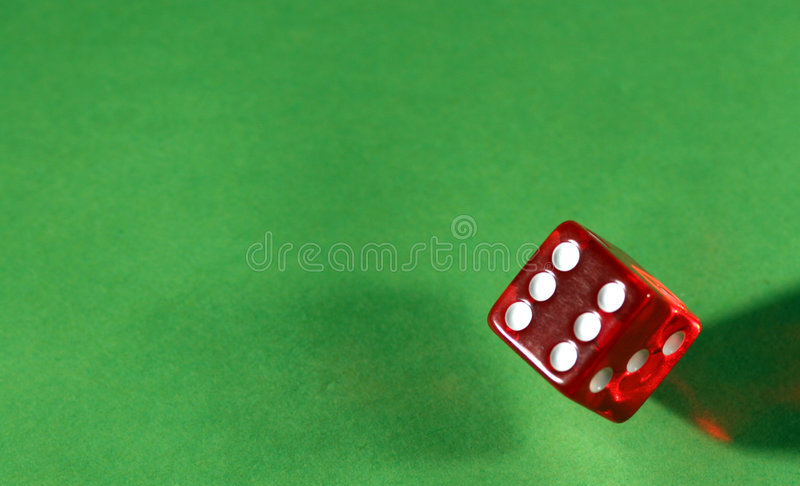 Rolling a six stock photos